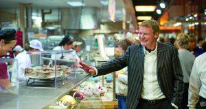 Danny Wegman interacts with employees inside a Wegmans store.