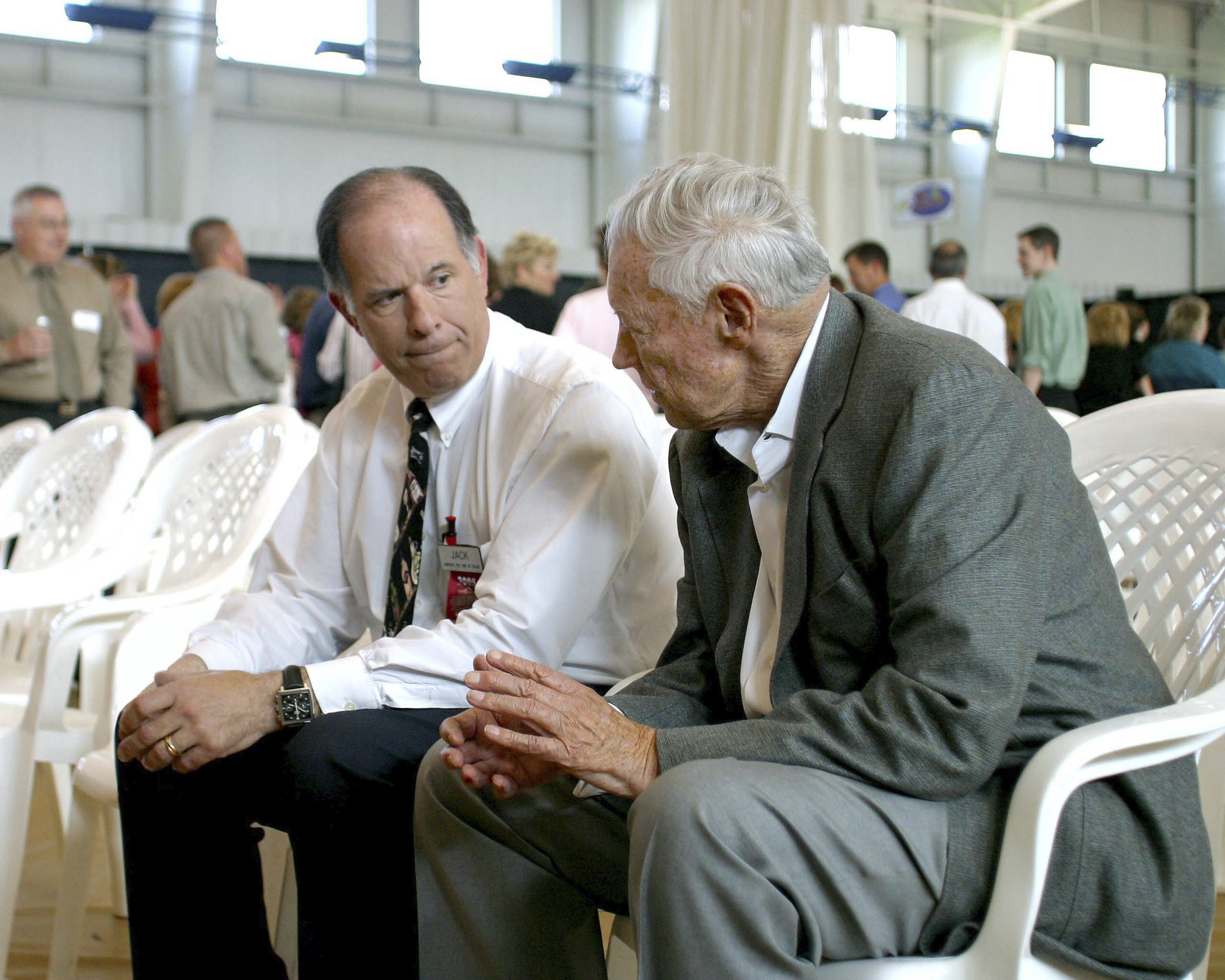 Jack DePeters, left, talks with the late Bob Wegman in 2005 at a party recognizing Wegmans as the No. 1 place to work in the country. (Courtesy Wegmans)
